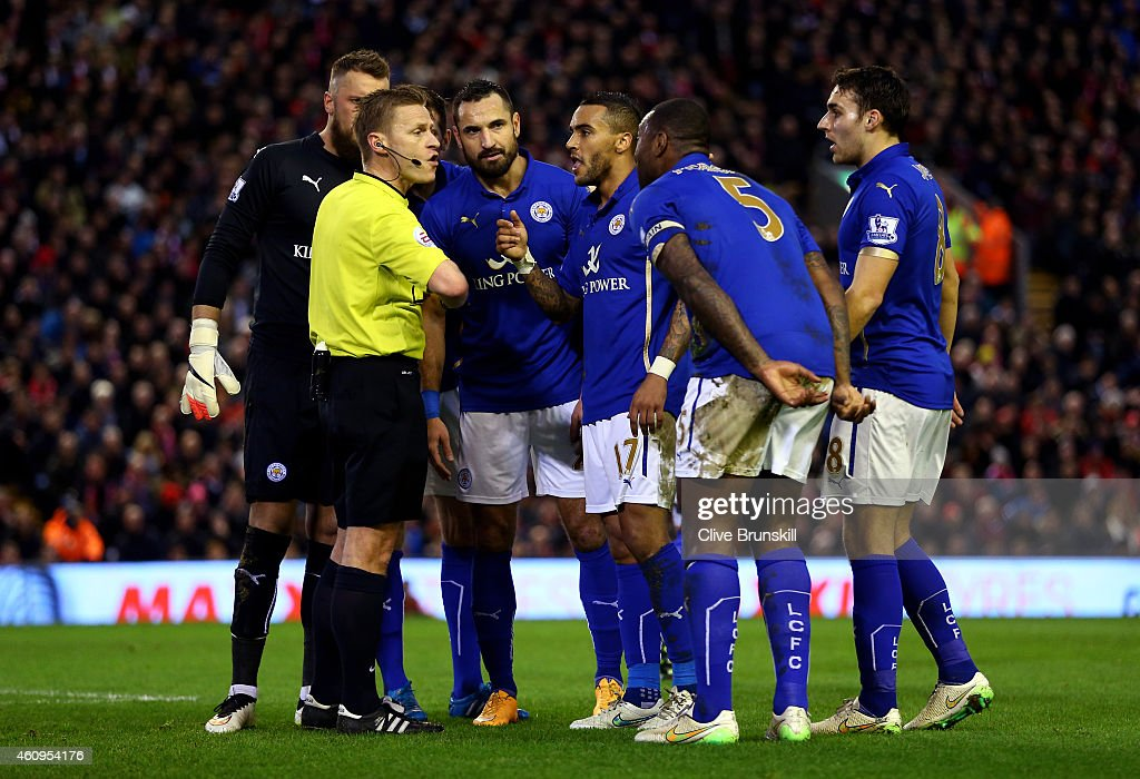 Leicester players protest to referee <a gi-track='captionPersonalityLinkClicked' href=/galleries/search?phrase=Mike+Jones+-+Arbitre&family=editorial&specificpeople=7275880 ng-click='$event.stopPropagation()'>Mike Jones</a> after he awards a penalty to Liverpool during the Barclays Premier League match between Liverpool and Leicester City at Anfield on January 1, 2015 in Liverpool, England.