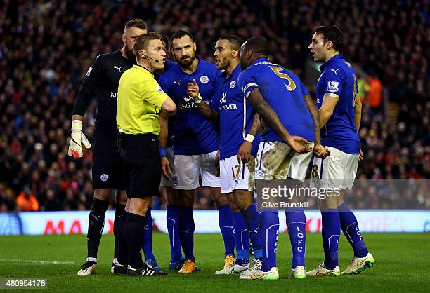 Leicester players protest to referee Mike Jones after he awards a penalty to Liverpool during the Barclays Premier League match between Liverpool and...