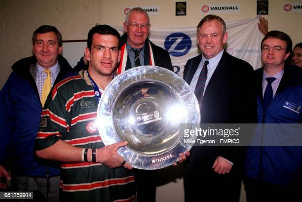 Leicester Tigers captain Martin Johnson lifts the Zurich Premiership shield watched by Zurich's James Hill and Wallace Dobbin and Leicester Tigers...