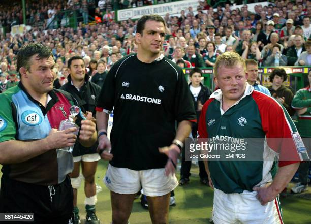 Leicester Tigers' captain Martin Johnson stands with teammate Dorian West and Harlequins' Jason Leonard afer their last games for respective clubs
