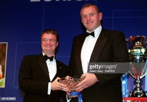 Leicester Tigers coach Dean Richards collects the Young Player of the Year Award on behalf of Lewis Moody from Wallace Dobbin of Zurich