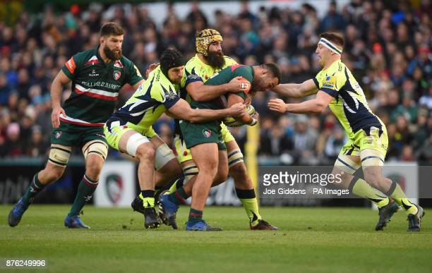 Leicester Tigers' Ellis Genge is tackled by Sale Sharks' Bryn Evans and Josh Straussduring the Aviva Premiership match at Welford Road Leicester