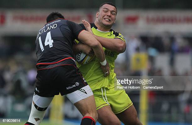Leicester Tigers' Ellis Genge is tackled by Saracens' Sean Maitland during the Aviva Premiership match between Saracens and Leicester Tigers at...