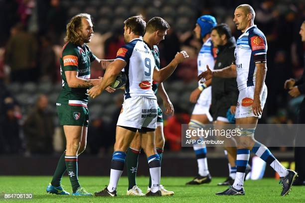 Leicester Tigers' English player Sam Harrison shakes hands with Castres' South African scrumhalf Rory Kockott after the European Champions Cup Pool 4...