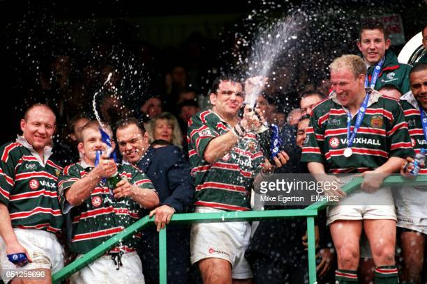 Leicester Tigers' Graham Rowntree and Martin Johnson crack open the champagne to celebrate winning the Zurich Premiership title