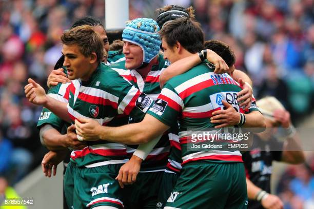 Leicester Tigers' Matt Smith celebrates his try with Ben Youngs and Toby Flood and Jordan Crane