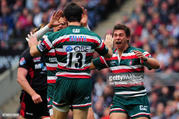 Leicester Tigers' Matt Smith celebrates his try with Ben Youngs and Toby Flood