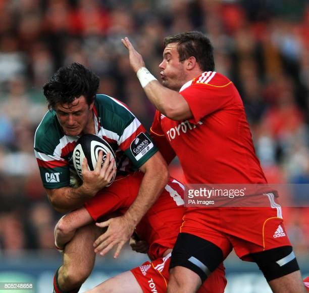 Leicester Tigers' Matt Smith is tackled by Munster's Danny Barnes and Denis Fogarty during the Guinness Challenge match at Welford Road Leicester