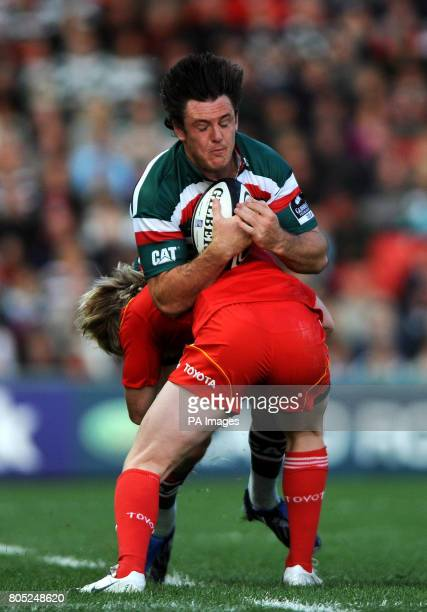Leicester Tigers' Matt Smith is tackled by Munster's Danny Barnes during the Guinness Challenge match at Welford Road Leicester