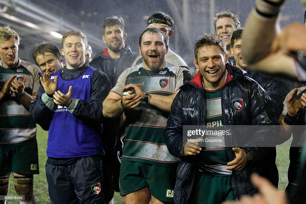 Leicester Tigers players including Fraser Balmain (centre) and <a gi-track='captionPersonalityLinkClicked' href=/galleries/search?phrase=Tom+Youngs+-+Rugby+Player&family=editorial&specificpeople=10880014 ng-click='$event.stopPropagation()'>Tom Youngs</a> (right) react during a presentation to mark the100th start for Dan Cole following the European Champions Cup match between Leicester Tigers and Benetton Treviso at Welford Road on January 16, 2016 in Leicester, England.