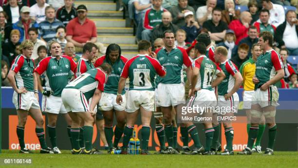Leicester Tigers' players stand dejected under the posts after conceding a try
