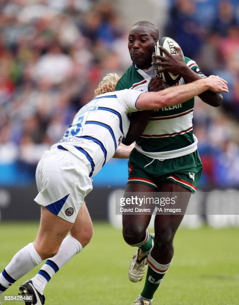 Leicester's Ayoola Erinle is tackled by Bath's Alex Crockett during the Guinness Premiership Semi Finals at The Walkers Stadium Leicester