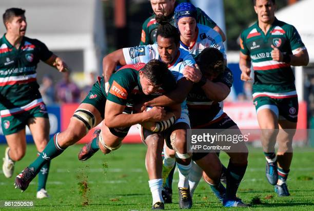 TOPSHOT Leicester's British lock Dominic Barrow vies with Racing 92's French winger Teddy Thomas during the Champions cup rugby union match between...