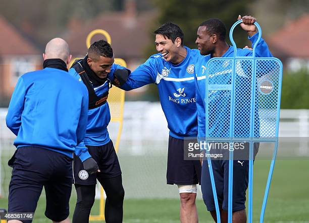 Leicester's Danny Simpson Leo Ulloa and Wes Morgan enjoy a joke during the Leicester City training session at Belvoir Drive Training Ground on April...