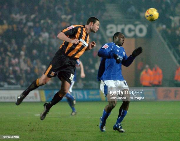Leicester's Elvis Hammond in action with Hull's Damien Delaney during the CocaCola Championship match at the Kingston Communications Stadium Hull