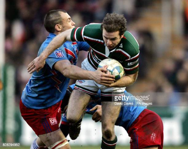 Leicester's Geordan Murphy is tackled by Stade Francais' David Auradou and Sergio Parisse during the Heineken Cup match at Welford Road Leicester...