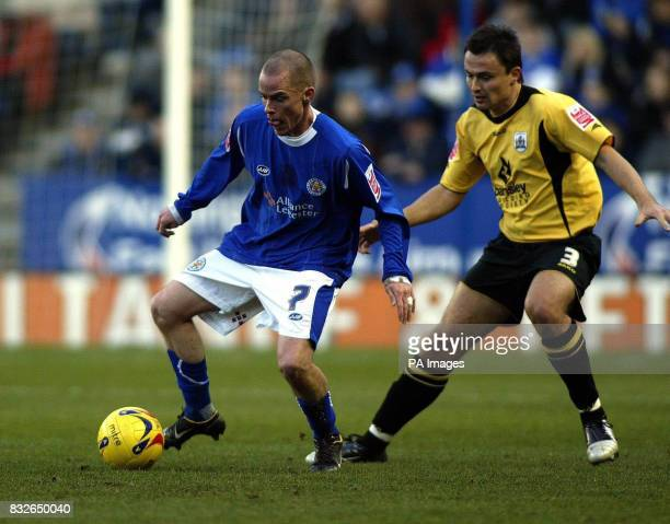 Leicester's Iain Hulme keeps the ball from Barnsley's Paul Heckingbottom during the CocaCola Championship match at Walkers Stadium Leicester