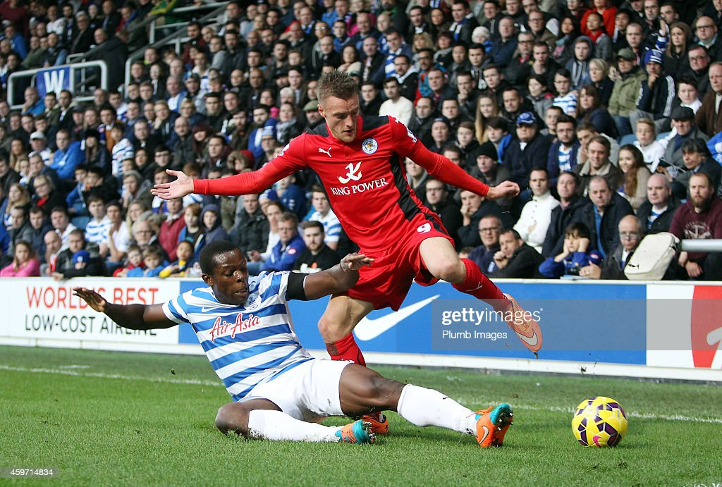 Leicester's Jamie Vardy battles with QPR's Nedum Onuoha during the Barclays premier League match between Queens Park Rangers and Leicester City at Loftus Road on November 29, 2014 in London, England.