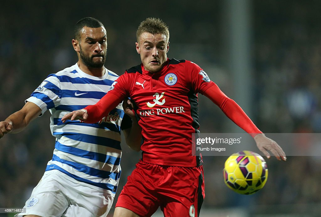 Leicester's Jamie Vardy battles with QPR's Steven Caulker during the Barclays premier League match between Queens Park Rangers and Leicester City at Loftus Road on November 29, 2014 in London, England.