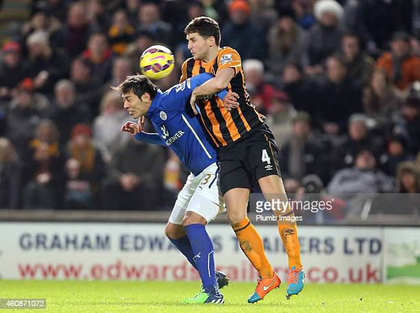 Leicester's Leo Ulloa with Hull's Alex Bruce during the Barclays Premier League match between Hull City and Leicester City at the KC Stadium on...