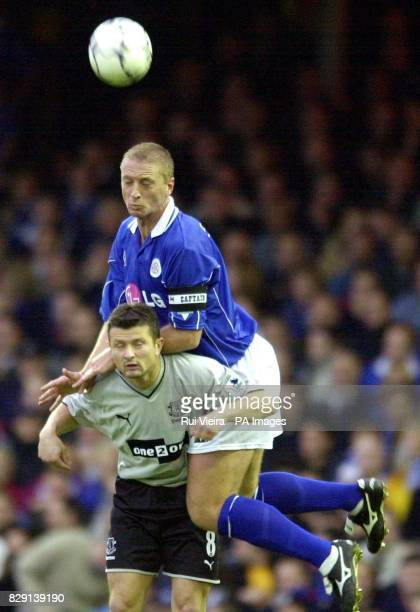 Leicester's Matt Elliott climbs above Everton's Tomasz Radzinski to head the ball during the FA Barclaycard Premiership game at Filbert Street...