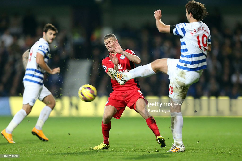 Leicester's Paul Koncheski battles with QPR's Niko Kranjcar during the Barclays premier League match between Queens Park Rangers and Leicester City at Loftus Road on November 29, 2014 in London, England.