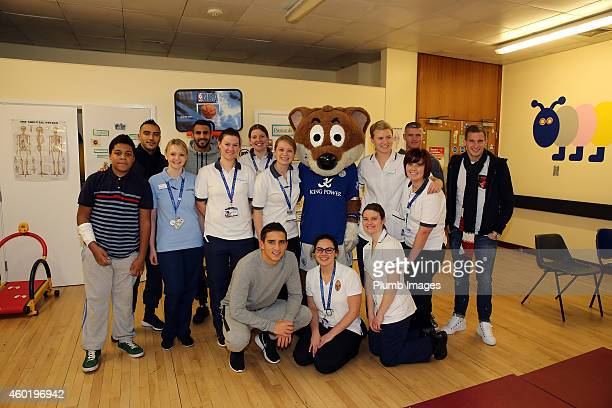 Leicester's Paul Konchesky Anthony Knockaert Marc Albrighton and Danny Simpson with staff nurses during the visit of Leicester City players to...