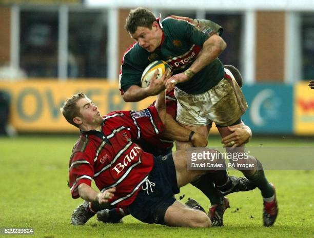 Leicester's Tim Stimpson is tackled by Gloucester's James SimpsonDaniel and Henry Paul during Gloucester's 1611 victory in the Powergen Cup semifinal...