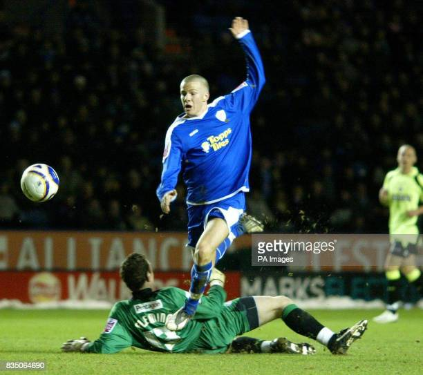Leicester's Tom Cleverley skips over Oldham goalkeeper Greg Fleming during the Coca Cola League One match at the Walkers Stadium Leicester