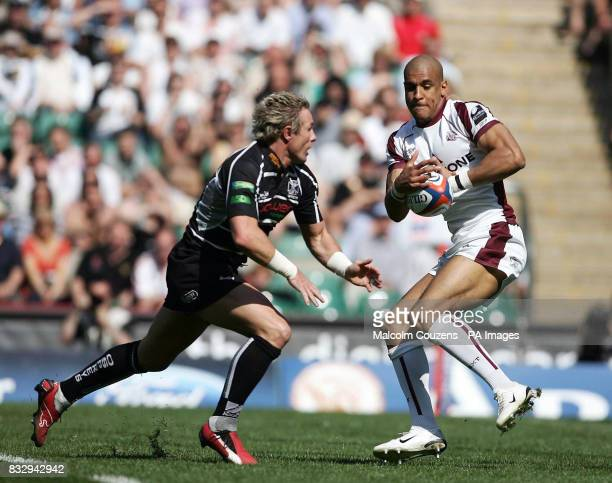 Leicesters' Tom Varndell breaks past Ospreys Justin Marshall to set up his try during the EDF Energy Cup Final match at Twickenham London