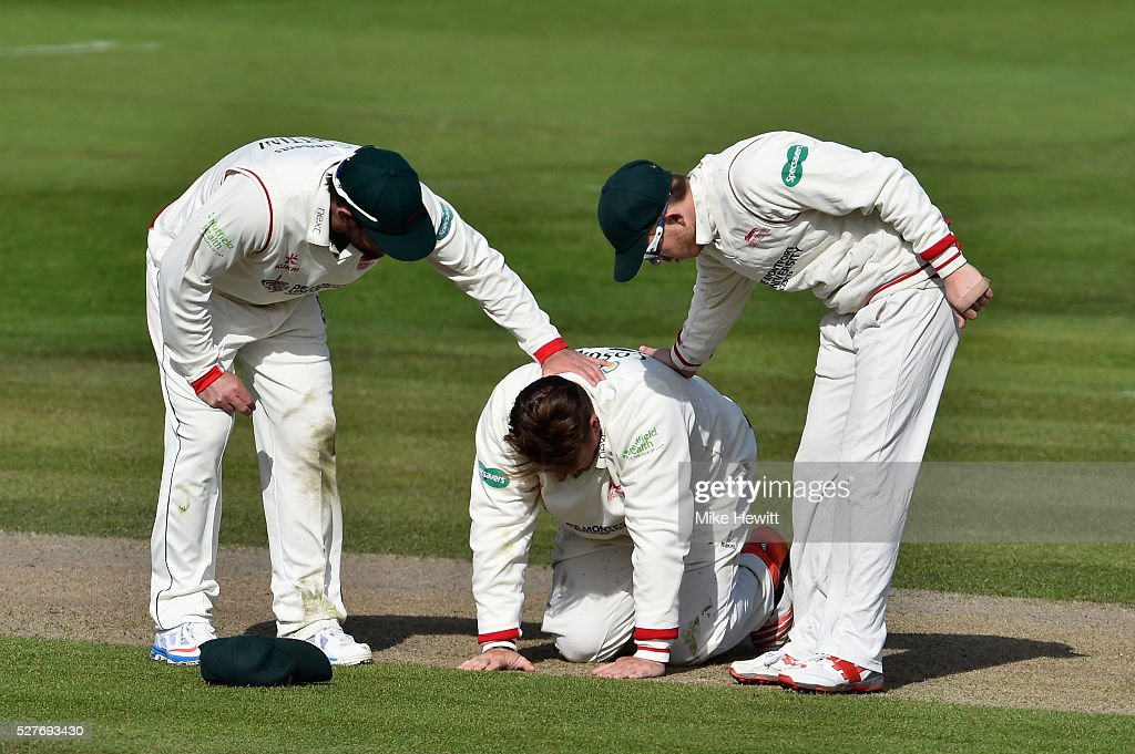 Leicestershire captain <a gi-track='captionPersonalityLinkClicked' href=/galleries/search?phrase=Mark+Cosgrove&family=editorial&specificpeople=227329 ng-click='$event.stopPropagation()'>Mark Cosgrove</a> is comforted by team mates after injuring himself in the field during the Specsavers County Championship Division Two match between Sussex and Leicestershire on May 03, 2016 in Hove, England.