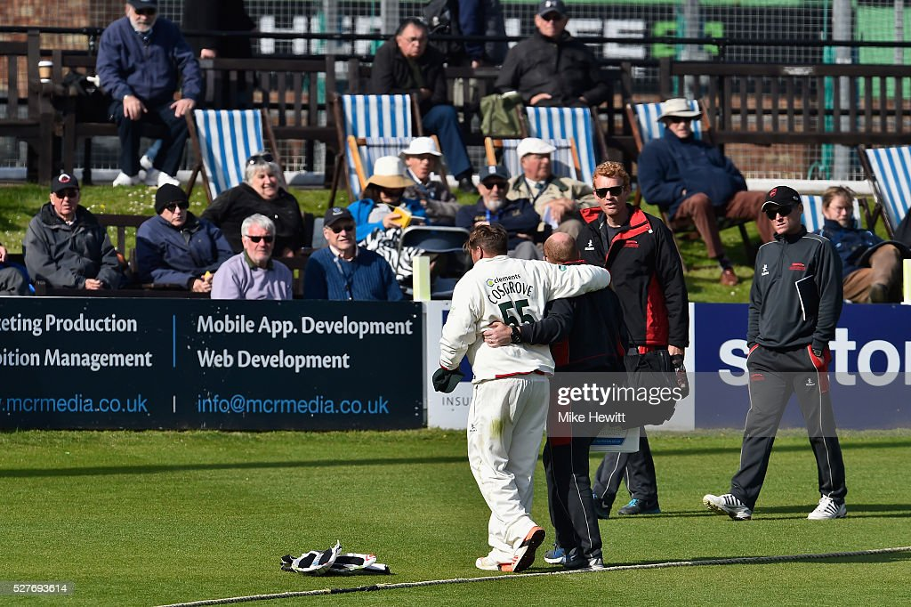 Leicestershire captain Mark Cosgrove is escorted off the field after injuring himself during the Specsavers County Championship Division Two match between Sussex and Leicestershire on May 03, 2016 in Hove, England.