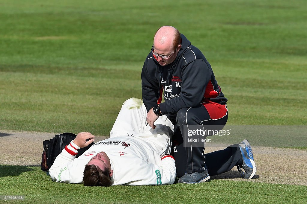 Leicestershire captain Mark Cosgrove receives treatment after injuring himself in the field during the Specsavers County Championship Division Two match between Sussex and Leicestershire on May 03, 2016 in Hove, England.