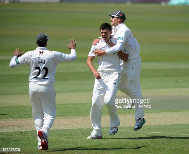 Leicestershire's Nathan Buck celebrates taking the wicket of Surrey's Mark Ramprakash
