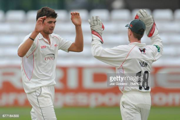 Leicestershire's Nathan Buck celebrates taking the wicket of Derbyshire's Tony Palladino