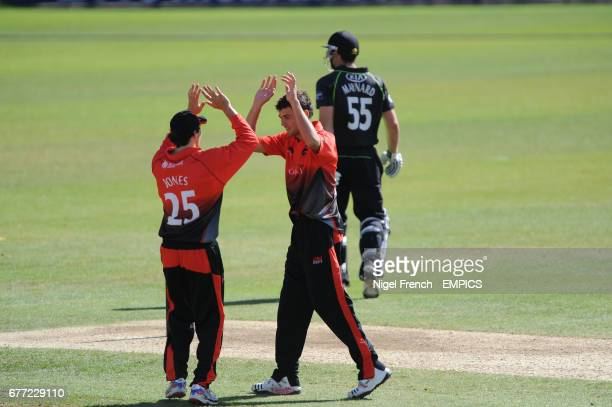 Leicestershire's Will Jones and bowler Nathan Buck celebrate taking the wicket of Surrey's Tom Maynard