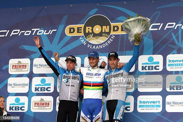 Leif Hoste Tom Boonen and George Hincapie at the winner ceremony after finishing the 90th edition of the Tour of Flanders in Belgium April 2 2006