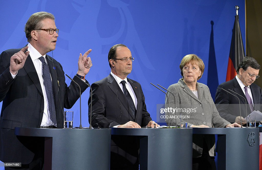 Leif Johansson, CEO of Ericsson and chairman of the meeting, French President Francois Hollande, German Chancellor Angela Merkel, and European Commission head Jose Manuel Barroso attend a press conference prior to the European Round Table of Industrialists on March 18, 2013 at the Chancellery in Berlin.