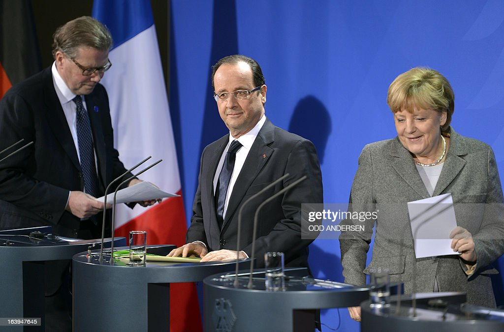 Leif Johansson, CEO of Ericsson and chairman of the meeting, French President Francois Hollande, German Chancellor Angela Merkel attend a press conference prior to the European Round Table of Industrialists on March 18, 2013 at the Chancellery in Berlin.