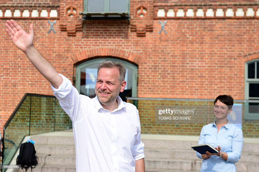 LeifErik Holm top candidate for regional elections of the Alternative for Germany party greets his supporters as he is applauded by AfD party...