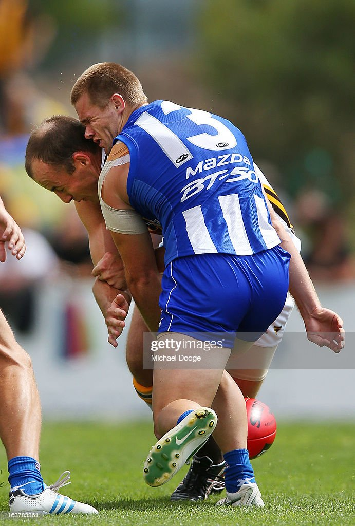 Leigh Adams of the Kangaroos gets gets hit in the head by <a gi-track='captionPersonalityLinkClicked' href=/galleries/search?phrase=David+Hale+-+Australian+Rules+Footballer&family=editorial&specificpeople=15090028 ng-click='$event.stopPropagation()'>David Hale</a> of the Hawks when contesting for the ball during the AFL NAB Cup match between the North Melbourne Kangaroos and the Hawthorn Hawks at Highgate Recreational Reserve on March 16, 2013 in Craigieburn, Australia.
