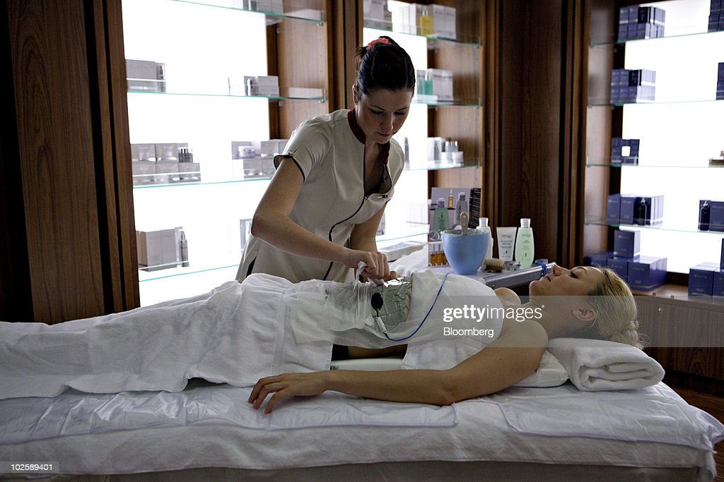 Leigh Ann Conroy A Beauty Therapist Applies Electrodes To The Stomach Of Crew Member Yulia ...