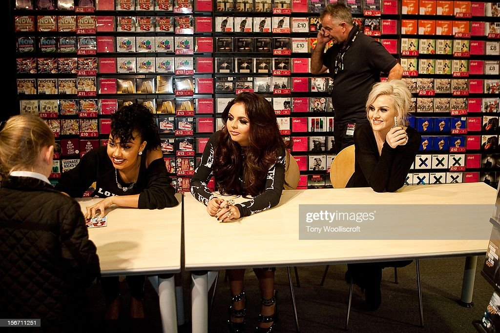 Leigh - Anne Pinnock and Jade Thirwell and Perrie Edwards of Little Mix meet fans and sign copies of their album 'DNA' on November 19, 2012 in Birmingham, England.