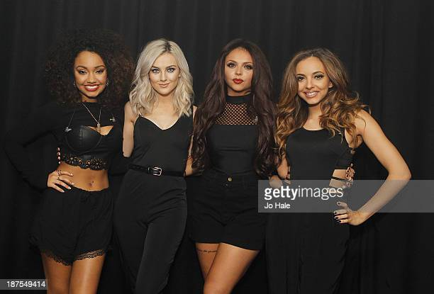 Leigh Anne Pinnock Perrie Edwards Jesy Nelson and Jade Thirlwall of Little Mix pose backstage at Heaven on November 9 2013 in London United Kingdom