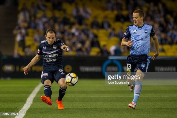 Leigh Broxham of Melbourne Victory clears the ball in front of Brandon ONeill of Sydney FC during Round 1 of the Hyundai ALeague Series between...