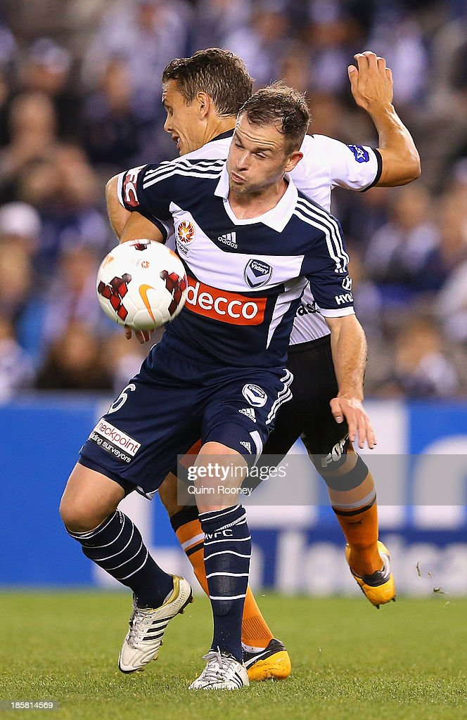 <a gi-track='captionPersonalityLinkClicked' href=/galleries/search?phrase=Leigh+Broxham&family=editorial&specificpeople=4103215 ng-click='$event.stopPropagation()'>Leigh Broxham</a> of the Victory and <a gi-track='captionPersonalityLinkClicked' href=/galleries/search?phrase=Jade+North&family=editorial&specificpeople=220626 ng-click='$event.stopPropagation()'>Jade North</a> of the Roar compete for the ball during the round three A-League match between Melbourne Victory and Brisbane Roar at Etihad Stadium on October 25, 2013 in Melbourne, Australia.