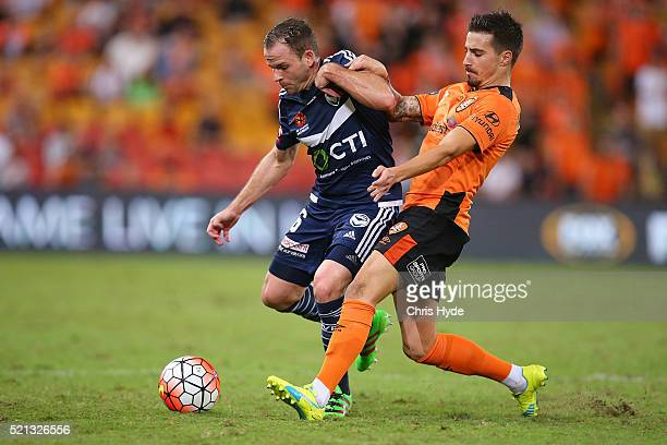 Leigh Broxham of the Victory and Jamie Maclaren of the Roar compete for the ball during the ALeague Elimination Final match between the Brisbane Roar...