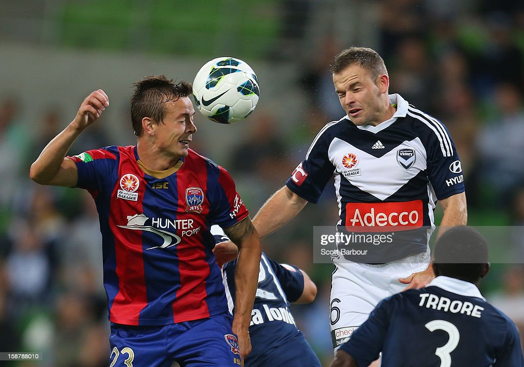 Leigh Broxham of the Victory and Ryan Griffiths of the Jets compete for the ball during the round 13 ALeague match between the Melbourne Victory and...