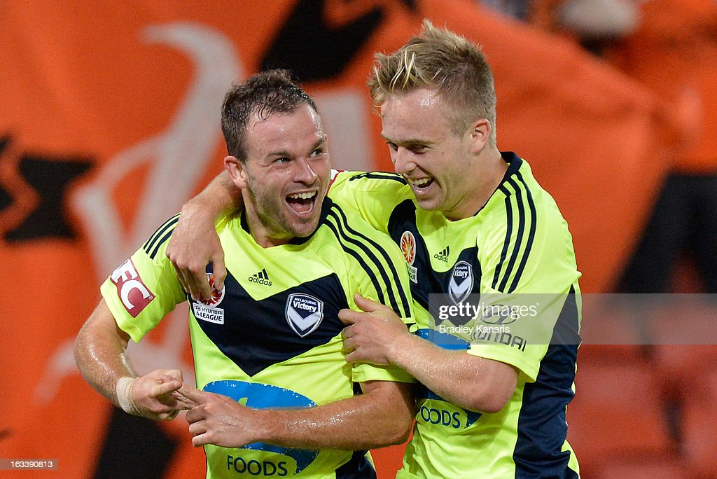 Leigh Broxham (L) of the Victory celebrates after scoring a goal during the round 24 A-League match between the Brisbane Roar and the Melbourne Victory at Suncorp Stadium on March 9, 2013 in Brisbane, Australia.