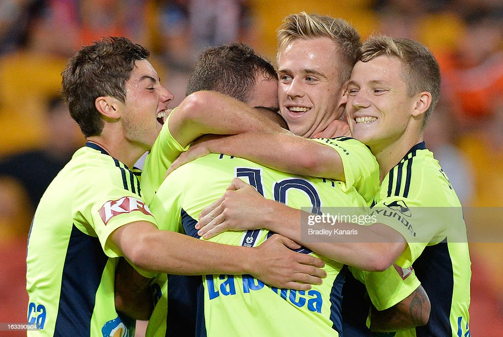 Leigh Broxham of the Victory celebrates with team mates after scoring a goal during the round 24 A-League match between the Brisbane Roar and the Melbourne Victory at Suncorp Stadium on March 9, 2013 in Brisbane, Australia.